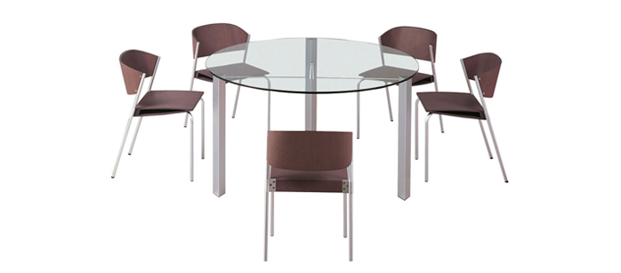 occhio-clear-round-table-wooden-chairs-beyond-furniture
